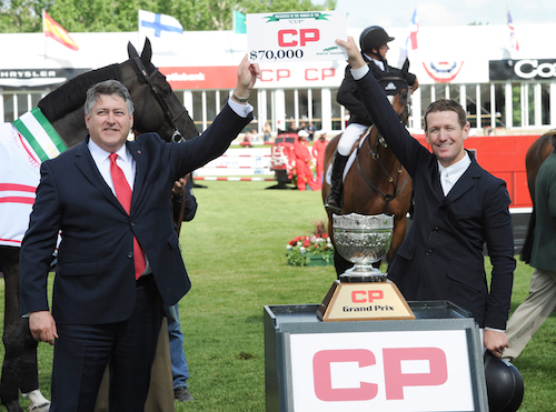 McLain Ward accepts his prize of $70,000 from Tim Marsh, Sr. Vice President, Sales & Marketing, Canadian Pacific Photo © Spruce Meadows Media Services